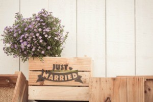 """Wood crate with """"Just Married"""" written on it."""