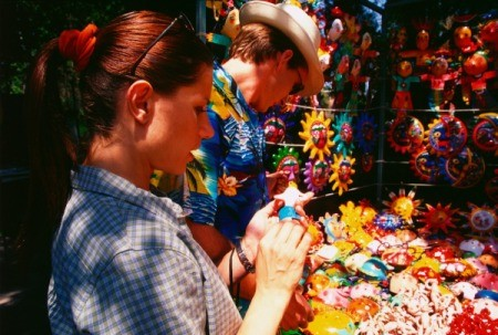 Couple looking at crafts at an outdoor market