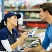 Man talking to paint store employee