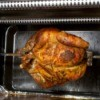 Home rotisserie oven with chicken on spin