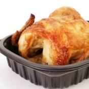 Rotisserie chicken in a plastic to go box