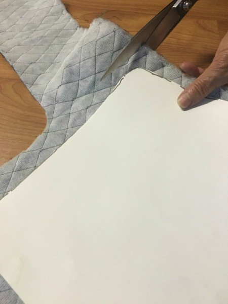 Cutting padded fabric for the chair.
