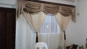 neutral curtains with sheers