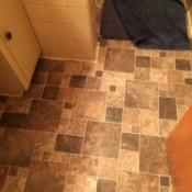 tile look vinyl flooring in browns and tans