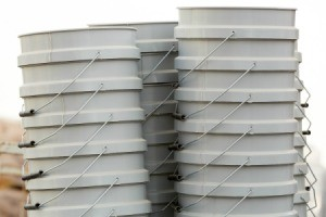 Stacks of 5 gallon buckets