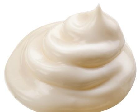 Pile of mayonnaise on white background