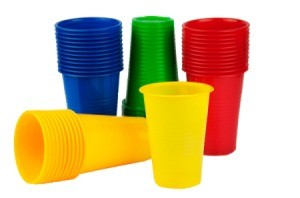 Four stacks of plastic cups red, yellow, green, and blue