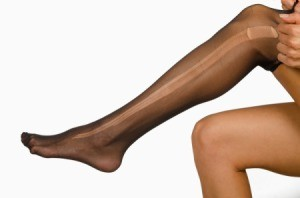 Women's leg with black hose that have a run in them