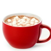 Red mug containing hot chocolate with mini marshmallows
