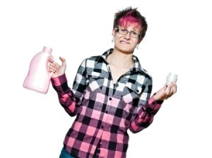 Distressed woman in shirt that is white hombre to pink holding laundry detergent bottle