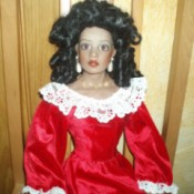 doll wearing a fancy red dress