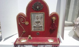 red wooden Buddha shrine