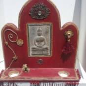 red wooden Buddha shrine