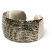 Silver bangle bracelet against white background