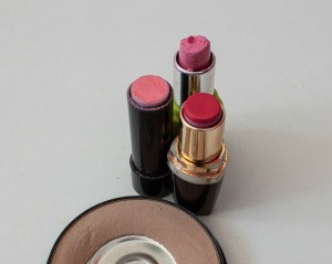 Three old used tubes of lipstick