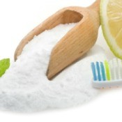 Baking Soda, Lemon, Mint and a Toothbrush displayed on a white background