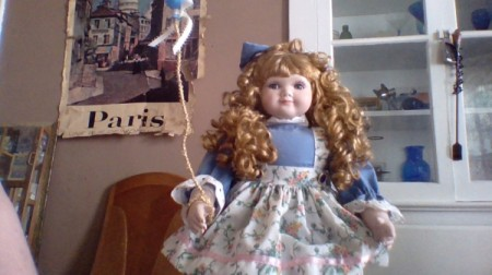 doll holding a balloon