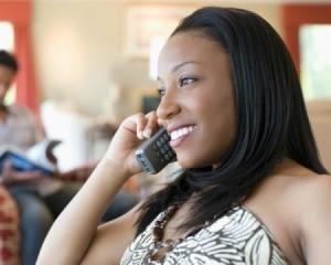 Woman talking on wireless telephone