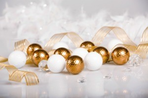 Gold and white golf balls with gold ribbon