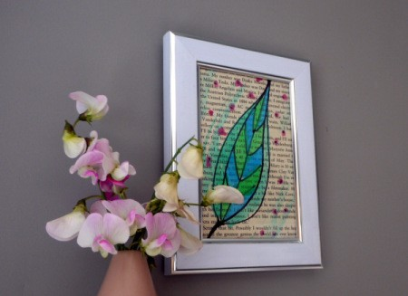 framed book page with watercolor artwork