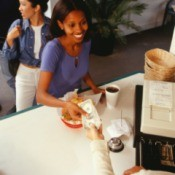 Woman paying for fast food