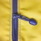 Purple plastic zipper in yellow fabric