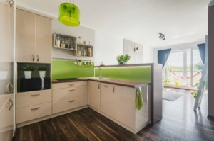 White kitchen with right green painted backsplash