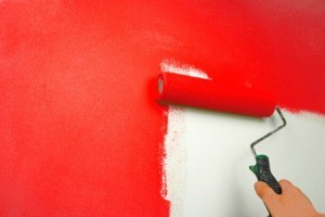 Paint Roller being used to paint walls red