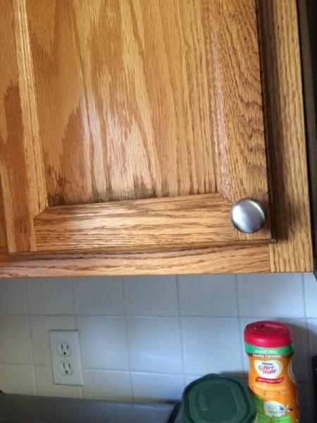 dark stains on cupboard door