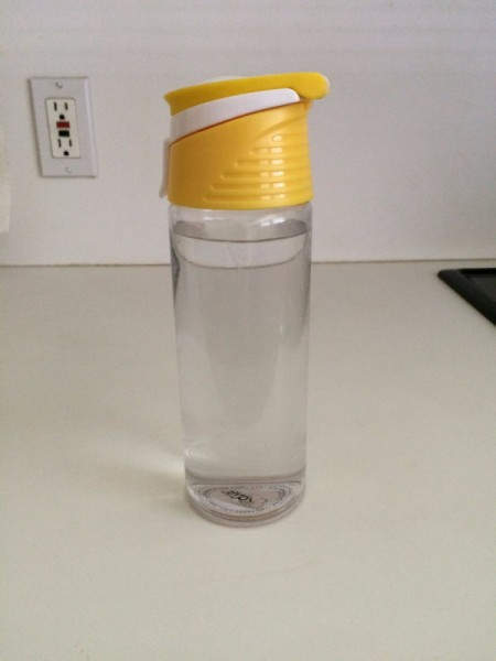 A water bottle on a kitchen counter.