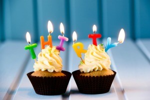 """Two cupcakes with candles spelling the word """"THIRTY"""""""