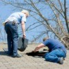 Two men working on a home's roof