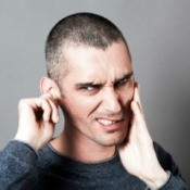 Man holding ear and neck in pain