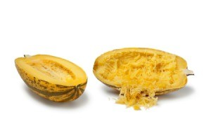 Spaghetti Squash cut in half with one half shredded