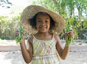 Girl holding two handfuls of fresh green beans