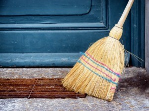 Old Broom leaning against a porch stoop