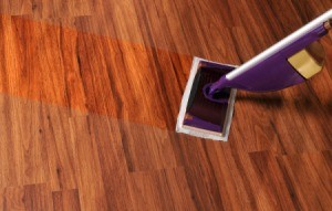 Floor being mopped with a Swiffer WetJet type modern mop