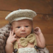 Infant wearing knitted newsboy cap