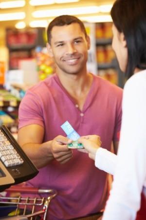 Man Using Food Stamps at Supermarket