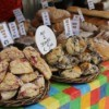 Scones and loaves of breads laid out with prices on a table