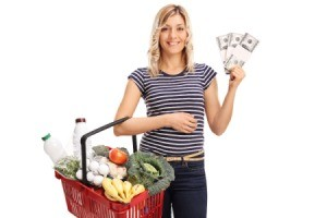 Woman with Shopping Absket and Coupons