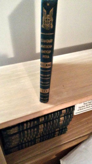 volumes on a shelf