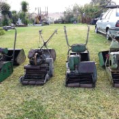 four old cylinder mowers