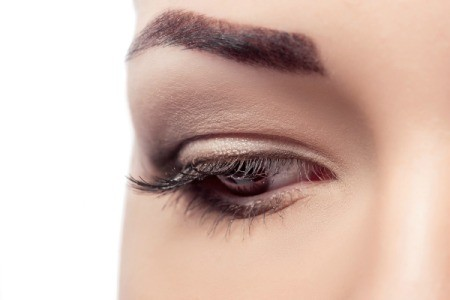 Close up of woman with stenciled eyebrow