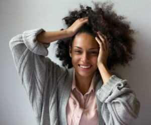 African American Woman with hands in her long natural hair
