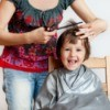 Mother cutting the her child's hair
