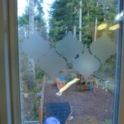 contact paper shapes being applied to small window