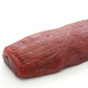 Raw Venison Loin isolated against a white background