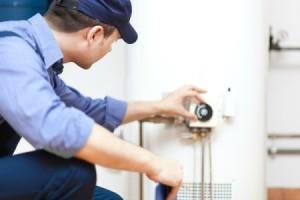 Repairman working on water heater