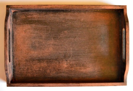 Lighter finish has been added to the wooden tray.